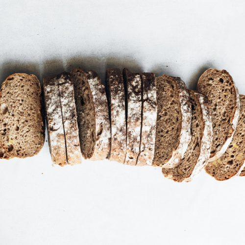A crusty loaf of bread on a white background. A source of the macronutrient carbohydrate