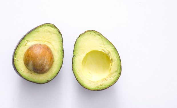 Two avocado halves, a good source of the macronutrient, fat.