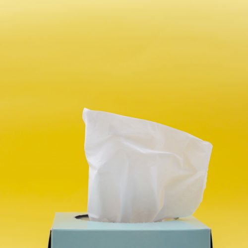 A light blue box of tissues with a vibrant backgroud.